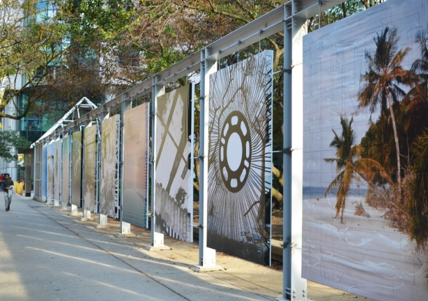 a line of 7 large photographs as part of a display by Metro Hall on King Street