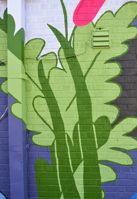 tall green plants in a mural by Claire Browne