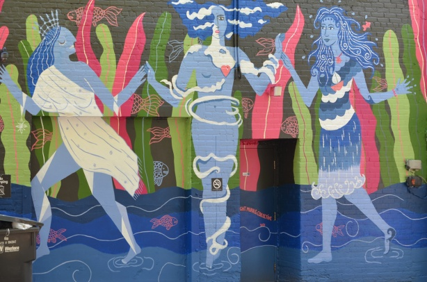 three water women mural on a wall