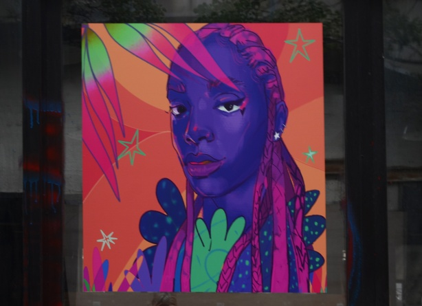 image by Curtia Wright, woman with purple skin and pink hair, head and shoulders portrait