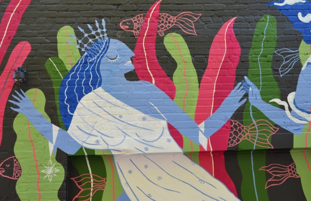 part of a mural with theme of water, blue woman dancing with eyes clsed